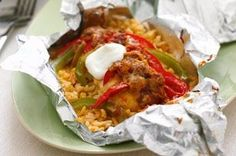 Foil-Pack Chicken Fajita1-1/2 cups  instant white rice, uncooked 1-1/2 cups  hot water 1 Tbsp.  TACO BELL® Taco Seasoning Mix 4 small   boneless skinless chicken breasts (1 lb.) 1  each green and red pepper, cut into strips 1/2 cup  TACO BELL® Thick & Chunky Salsa 1/2 cup  KRAFT Mexican Style Finely Shredded Taco Cheese