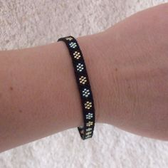 Black Seed Bead Bracelet With Flowers