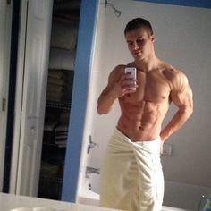 Dan Rockwell wearing just a white towel