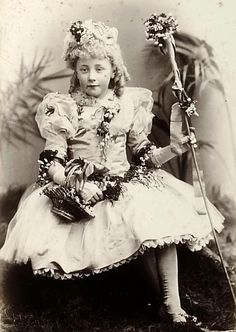Little girl poses in flouncy fancy dress at the ball Victorian children in fancy dress costumes for the Mayor and Mayoress of Leeds' silver wedding ball in 1891