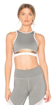 Bowie Sports Bra by Haute Body. Self: 90% nylon 10% spandexContrast: 85% nylon 15% spandex. Stretch fit. Contrast sheer mesh fabric. Back cut-out. HT...
