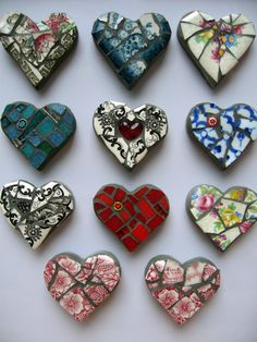 Sweet mosaic mini hearts. Just plaster of paris of craft cerement in the ikea heart ice cube tray, and some broken plates, cups or mugs- goodness knows I need paperweights with my art... bigger ones though. At this point I still scramble and have to get real creative. :)
