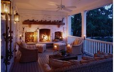 Covered porch with fireplace and candles. Romantic and cozy.