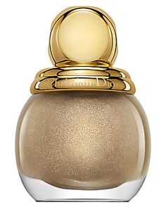 Dior Diorific Nail Lacquer $26 - Feel like a million bucks when you paint your nails with this dashing and luxurious gold sparkle polish from Dior. Yes, please!