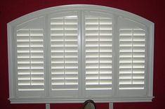 4 1/2 inch louver shutters with eyebrow arch framed with curved L frame
