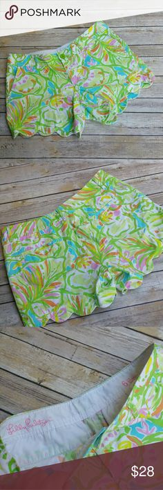 """Lilly Pulitzer The Buttercup Short Scallop Shorts Beautiful  traditional lilly pulitzer color pallete on these scalloped hemline shorts. """"The buttercup shorts """" Excellent condition. Button closure. Tagged size 6. Measurements: Length 12"""" 4 1/2"""" Inseam  15"""" across front waist laying flat  Styled with our lilly pink waterfall cardi and bubble necklace which are not included. #ravenkittystyle #buttercup #lillypulitzer #thebuttercupshorts #size6 #lilly #scallop #prep #preppy #girly Lilly…"""
