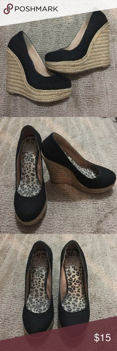 Black Wedge Sandals Black canvas wedge sandals with espadrille style heels. Size 6 but runs slightly small. Worn once or twice, in good condition with no scuffs or stains. Delicious brand. Shoes Sandals