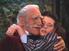 "Sir C. Aubrey Smith and Margaret O'Brien in a tear-jerking scene from MGM's 1949 Technicolor remake of ""Little Women."""