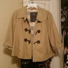 American Eagle khaki jacket Khaki jacket. Fold over collar. 3/4 length sleevs. 3 dark brown buttons on front. Great condition. 100% cotton American Eagle Outfitters Jackets & Coats Blazers