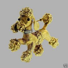 Cartier poodle pin, circa 1950's in 18 K yellow gold with onyx eyes