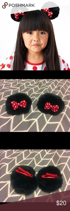 Disney Minnie Mouse Ear Clips. Ears on Snap Clips Authentic Disney Minnie Mouse Ear Clips. Purchased at Disney Land. Soft black faux fur ears. Plush red with white polka dots. Red snap Clips offer secure and hidden attachment to hair.  Thank You for your Interest!! ❌NO Trades❌ Fair Offers AcceptedWant MORE For LESS?✨Use the BUNDLE DISCOUNT: 4️⃣Items=20%OFF!!✨Can't find 4️⃣you like? Ask me to make you a custom BUNDLE. Disney Costumes Halloween