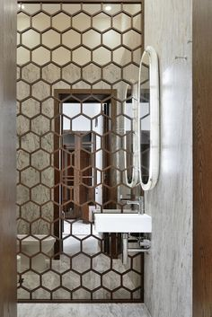 Hexagon mirrored wall. Bathroom design idea.