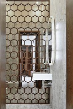 Hexagon mirrored wall. Bathroom design idea.