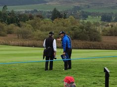 Discussing with Matt Adams between the ropes during Ryder Cup'14.