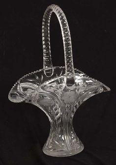 "Circa 1900 20"" tall cut glass basket with a wheel cut flower design."