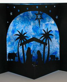 This is the inside of the 3d card nativity scene by Silhouette Cameo. I used alcohol ink to made the blue background.