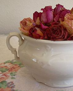 Antique chamber potty full of dried roses makes for a special conversation piece