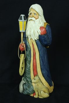 """Santa and the Animals, a 12"""" tall Santa  hand carved out of Basswood by Susan L. Hendrix"""