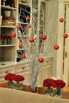 paint sticks and branches white to put in a glass vase and hang red ornaments on.