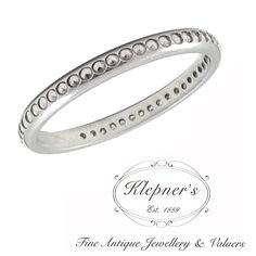 VINTAGE INSPIRED ELLIPSE PATTERN BAND RING. This inspired wedding band can be customized to include any combination of diamonds and/or gemstones such as sapphires, rubies, emeralds, birthstones, anniversary stones, etc & can be crafted in 9ct or 18ct white, rose or yellow gold, platinum or sterling silver.This ring is available with or without any number of round cut gemstones or diamonds measuring:  1.00mm in diameter & weighing approximately 0.005ct to 0.02ct each.