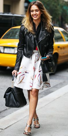 While out in N.Y.C., Jessica Alba hit the street in a biker jacket, printed Prabal Gurung skirt, black Dolce & Gabbana tote and leather Rupert Sanderson sandals.