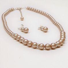 Check out this item in my Etsy shop https://www.etsy.com/listing/65804803/swarovski-powder-almond-pearl-set