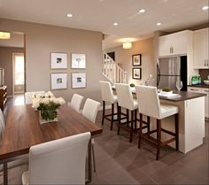 Cardel Designs - kitchens - mocha walls, mocha paint, art gallery, open floor plan, matte floors, Ivory barstools, leather barstools, ivory leather barstools, walnut dining table, chrome dining table, white dining chairs, leather dining chairs, white leather dining chairs, shaker cabinets, white shaker cabinets, white kitchen cabinets, pot lighting, recessed lighting, eat in kitchen,