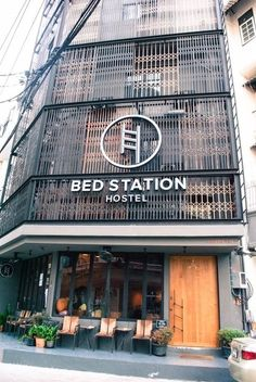 In front of the Bed station Hostel Counter at bed station at Bed Station Bangkok… Facade Design, Exterior Design, Architecture Design, Building Exterior, Building Facade, Retail Facade, Capsule Hotel, Building Signs, Marquise
