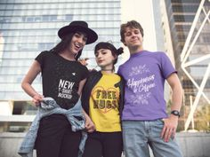 Shot of Three Young Friends Hanging Out in the City While Wearing Different Tshirts Template a15731