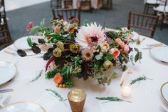 Rich, saturated berry tones and unique textural elements combine for an elegant, show stopping display. Set in Seattle historic Union Station, this grand affair was one to remember. Fruit laden branches, lush dinner plate dahlias and delicate garden roses graced every bouquet.  Flowers grown & designed by Floret | Photo by GH Kim Photography