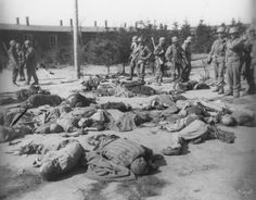 US soldiers confront corpses of prisoners killed  in Ohrdruf before liberation