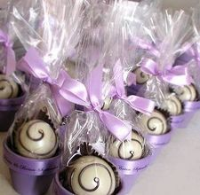 Favors - truffles in a painted pot of your wedding colors. Write the couples name and date around the briim