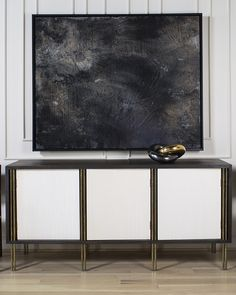 KELLY WEARSTLER | MELANGE CREDENZA. Legs feature parallel bars of burnished brass, and solid, luxe wood with a credenza accented in combed plaster.
