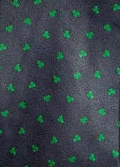 This 100% silk necktie designed by MMG for Hallmark has kelly green shamrocks on a navy blue background perfectly designed put you on The Best Dressed list for St. Patrick's Day.  When you wear it, prepare for compliments!  This designer tie is part of a store liquidation closeout and comes NWOT in plastic sleeve with FREE SHIPPING.