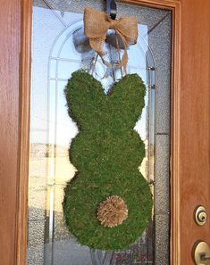 This simple moss covered bunny door hanger is the perfect piece of farmhouse decor for Easter and spring! Burlap Door Decorations, Easter Table Decorations, Easter Decor, Dollar Tree Decor, Dollar Tree Crafts, Easter Projects, Easter Crafts, Diy Projects, Spring Crafts