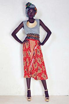 gray tank + red print skirt with contrasting cummerbund (Suno Spring 2010 Runway)