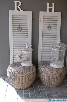 """Love these cane """"tables"""". Bird cages are pretty cool too!"""