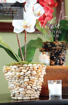 Original pin from Hobby Lobby: Use our versatile river stones to update your favorite space. - I would skip the faux moss and faux flower and use it as a planter for a live plant on my back deck!