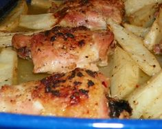 Amazing Baked Lemon Garlic Chicken Thighs and Potatoes from Food.com:   								This is one of the best chicken dishes I have ever had.  The garlic, lemon and chicken drippings make the most flavorful soft delicious potatoes. Super easy to prepare - the oven does all the work.