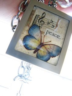 """""""Simply Adorned"""" charms from Stampin' Up.  They're tiny frames with beveled glass--open up for you to put in tiny pieces of art or photos."""