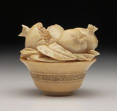 Kaigyokusai (school of) (Japan) Bowl with Pomegranates, late 19th-early 20th century Netsuke, Ivory with sumi