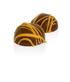 Raspberry with a Hint of Orange: These eye catching milk Chocolate domes are lovingly hand finished and combine the unusual contrast of raspberry and orange flavours.