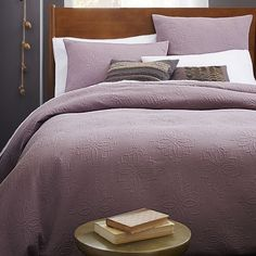 Luxe layer. The Organic Medallion Matelasse Duvet's textured diamond pattern combines the relaxed appeal of a classic quilt with the sumptuous feel of crisp organic cotton. In light amethyst, it's an ideal base for layering on pillows and throws.