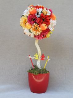 Bright orange topiary birthday centrepiece with gerberas and apples from Sarina's Garden.