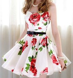 cute summer dress super cute i love it the roses , the belt , that it has straps , a sweetheart neck line.