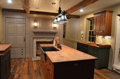 A fireplace in the kitchen... My ultimate dream kitchen would include a fireplace!