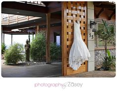 A beautiful, entrance to the Hale Ko'olani Estate and Linden and Brett's Maui Wedding. Linden's elegant gown hangs from the entrance slider. Florals by Dellables. Rentals from Pacific Isle Rentals. Wedding planning by Tori Rogers of Hawaii Weddings by Tori Rogers. Photo by Zasey Photography www.hawaiianweddings.net