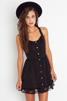 Black button up dress with lace trim at hem