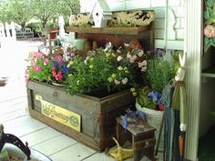 DIY: Vintage Carpenter Box - repurposed box now on the porch, holds  potted plants.