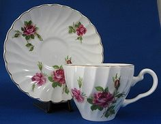 This is a Johnson Brothers, England cup and saucer made in a swirl molded pattern with lovely roses and gold trim. The ironstone tea cup and saucer was made 1940-1950s